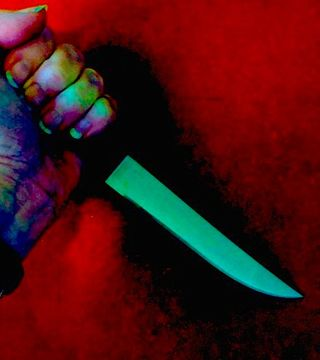 multi coloured image of hand holding a knife